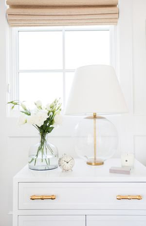 bedside lamp with white top and clear glass bottom