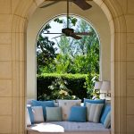 Best Outdoor Ceiling Fan Arched Walls White Sofa White Wall Sconces Blue And White Patterned Pillows Greenery Beige Walls
