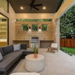 Best Outdoor Ceiling Fan Grey Sectional Couch White Round Coffee Table Wall Sconces Black Side Table Striped Pillows Concrete Floor Outdoor Grill Glass Doors