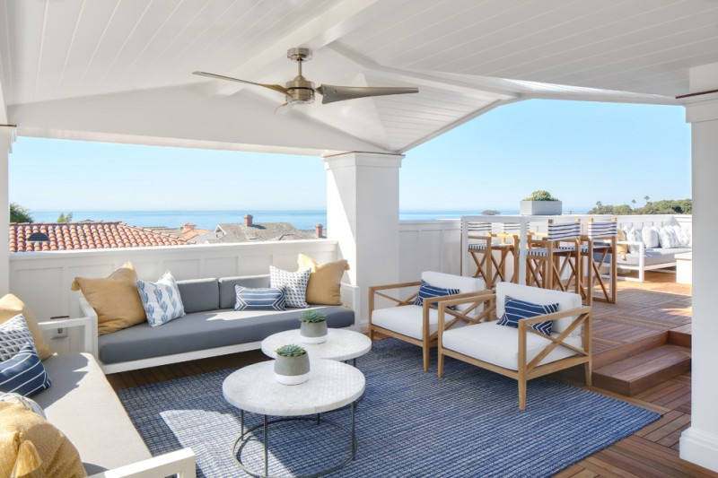 best outdoor ceiling fan whte ceiling wooden chairs white sofas grey cushions colorful pillows white coffee tables textured blue area rug wooden floor wooden stools