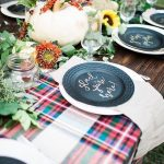 Dining Table With Fall Decorations, Plaid Tablecloth, Black Plate, Flowers, Pumpkn, Clear Glasses