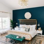 Elegant Rattan Bedding In Teal White Painted Room With Big Rug, Chandelier, White Fur Decoration