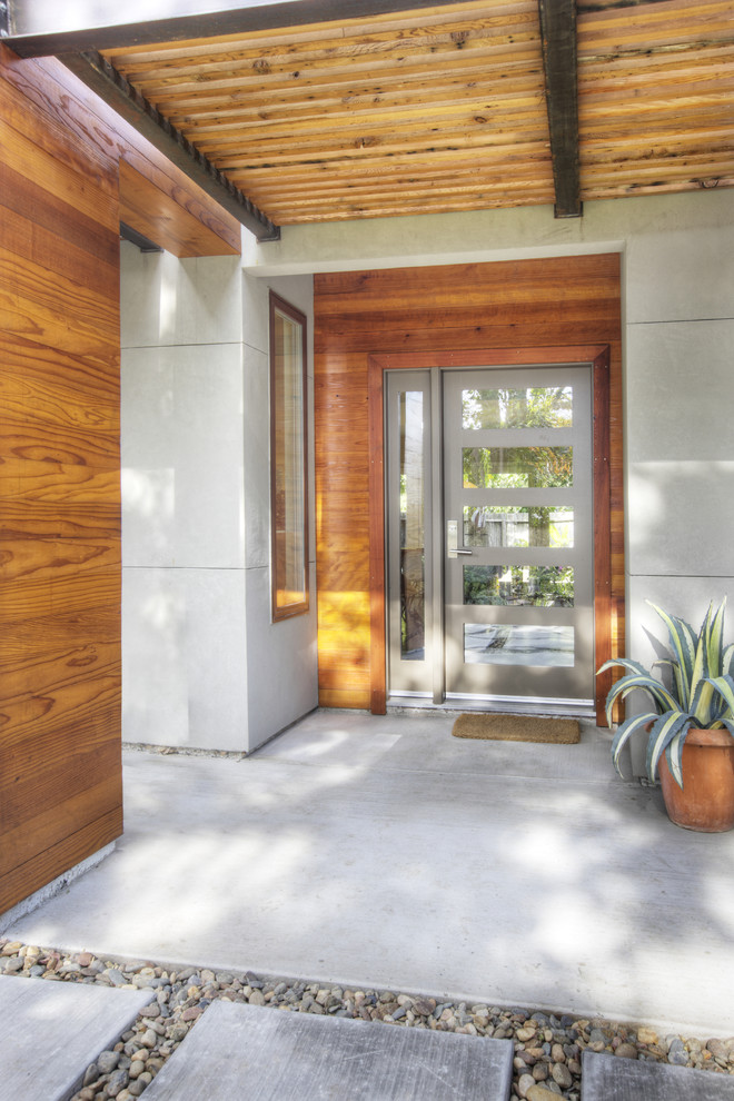 entry door with one sidelight grey door five glass panels grey framed sidelight wooden walls window concrete flooring outdoor mat