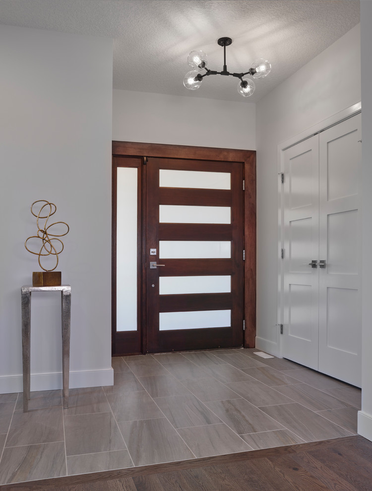 entry door with one sidelight opaque glass transitional flooring wooden floor brown tile floor decoration chandelier