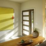 Entry Door With One Sidelight Yellow Artwork Wooden Entrywat Table Floor Lamp Grey Sofa Glass Window Grey Floor