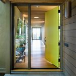 Entry Door With One Sidelight Yellow Door Wooden Wall Glass Wall Concrete Floor Wall Sconce Recessed Lighting Green Walls