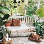 Front Porch With Rugs, Brown Pillows, Pendants, Plants, Brown Wooden Table