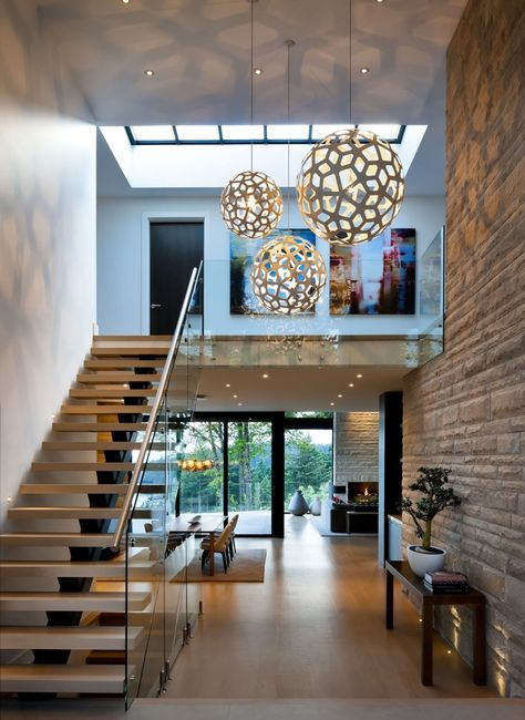 globe shaped with perforated surface as pendants near the stairs
