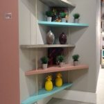 Grey Wall With Blue, Pink, Grey Wooden Shelves Zigzagging On The Corner