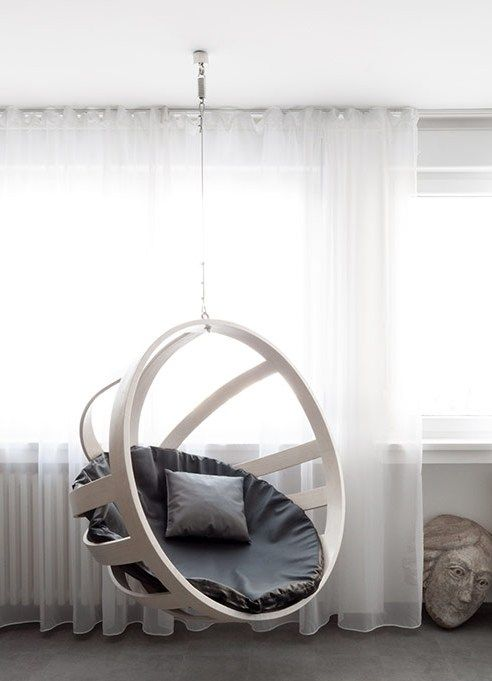 half round white framed plastic swing with grey cushion