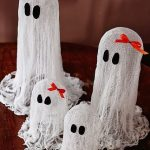 Halloween Table Accesories In White Clothes