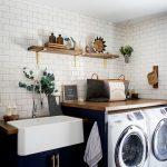 Kitchen With Large White Sink, Dark Electric Blue Cabinet, Brown Wooden Kitchen Top With Washing Machine Under,