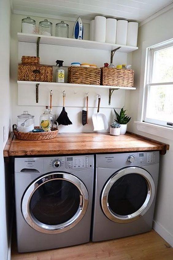 kitchen with one corner for grey washing machine under brown wooden kitchen top