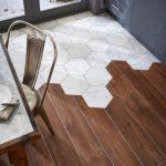 Kitchen With Wooden Floor Combined With White Hexagonal Tiles Near The Door