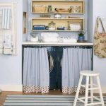 Kitchen With Wooden Floor, Striped Rug, Washing Machine Under The White Top For Deterjen, Blue Curtain