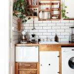 Kitchen With Wooden Floor, Wooden Kitchen Cabinets And Top, Washing Machine Under The Kitchen Top