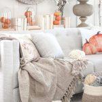 Living Room With Light Grey Rug And Sofa, Pumpkin Pillow, Pumpkin Decorations, Mirror
