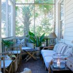 Long Small Sunroom With Rattan Sofa, Chairs, Storages, Plants, Lamps, Candles