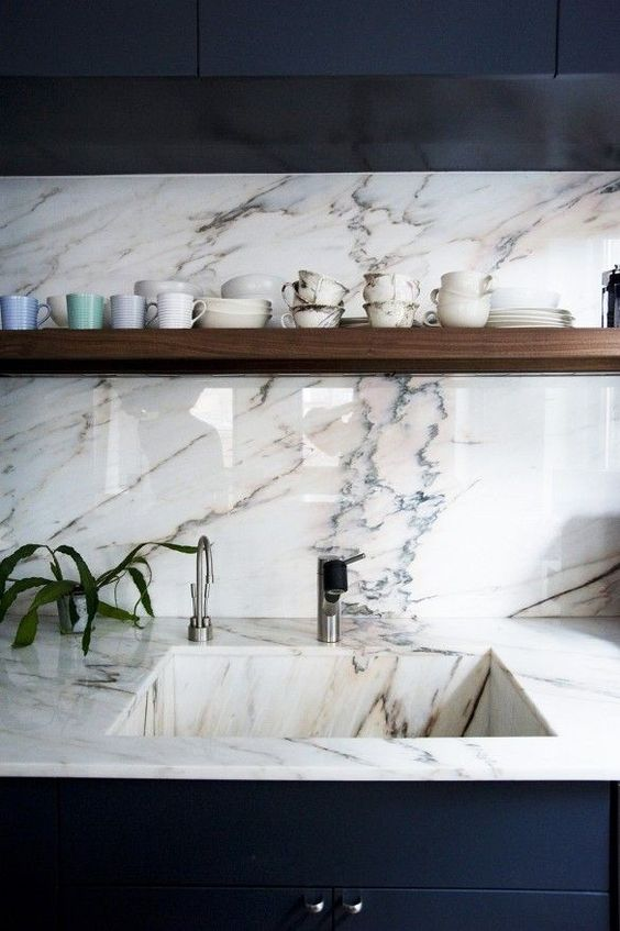 marble backsplash, wall, kitchen top, sink with continued pattern