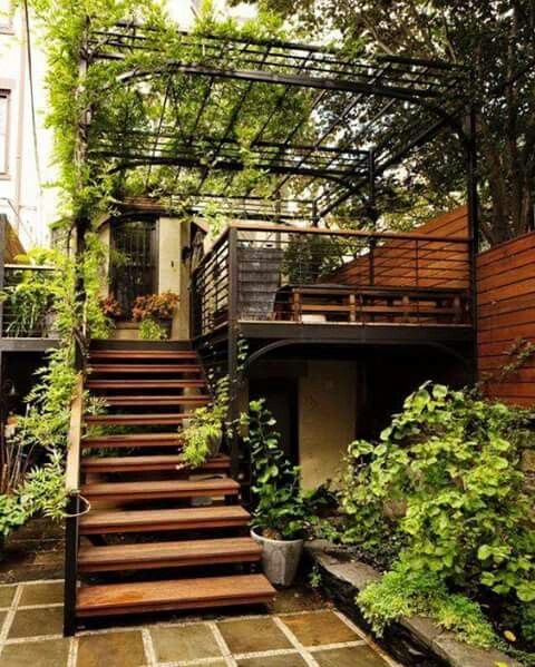 open strium in second floor with wooden flooring, wooden gate, plants vine on the ceiling