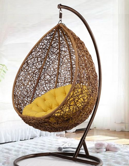oval shaped hanging chair from rattan with yellow cushion