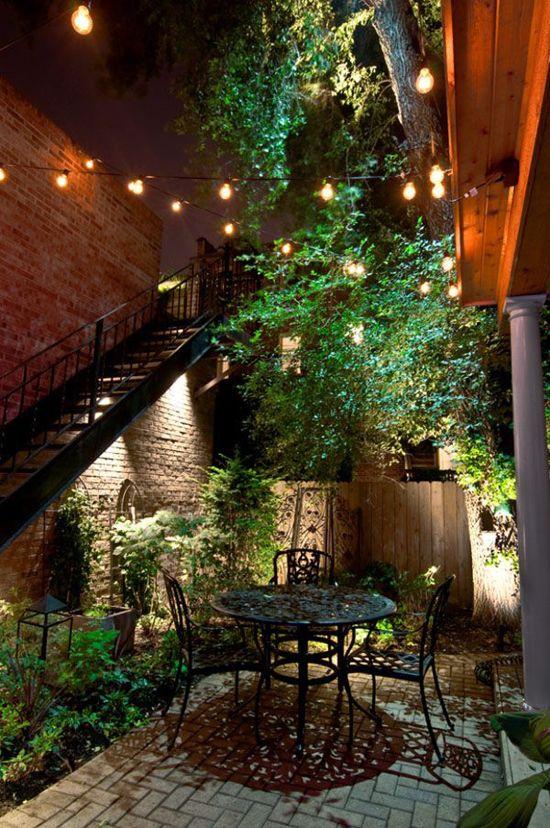 patio atrium with conblock, metal patio table set, plants, wooden sticks gate