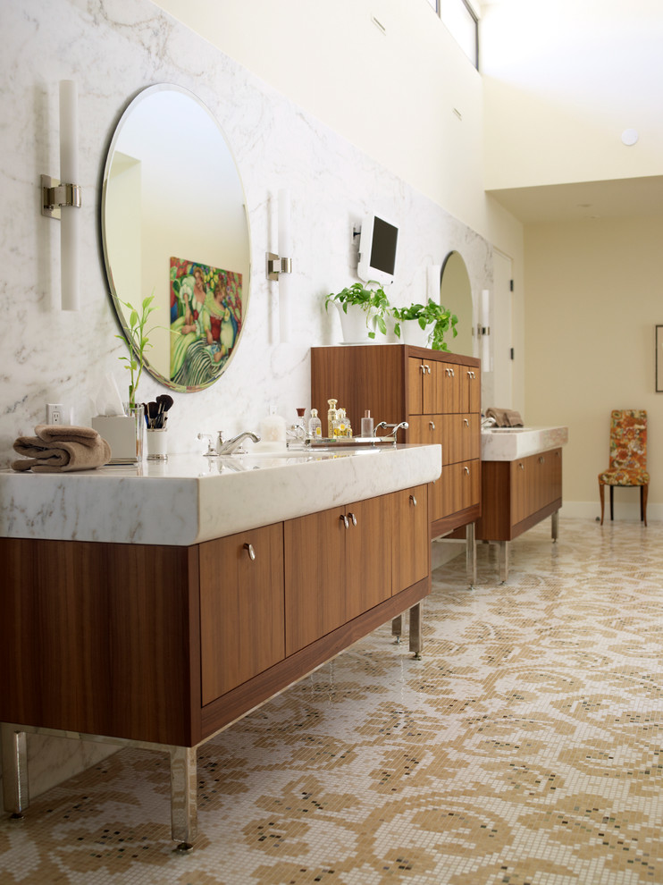 polished nickel mirror patterned mosaic floor tile wooden floor wall sconces white marble countertop white marble wall wooden cabinet