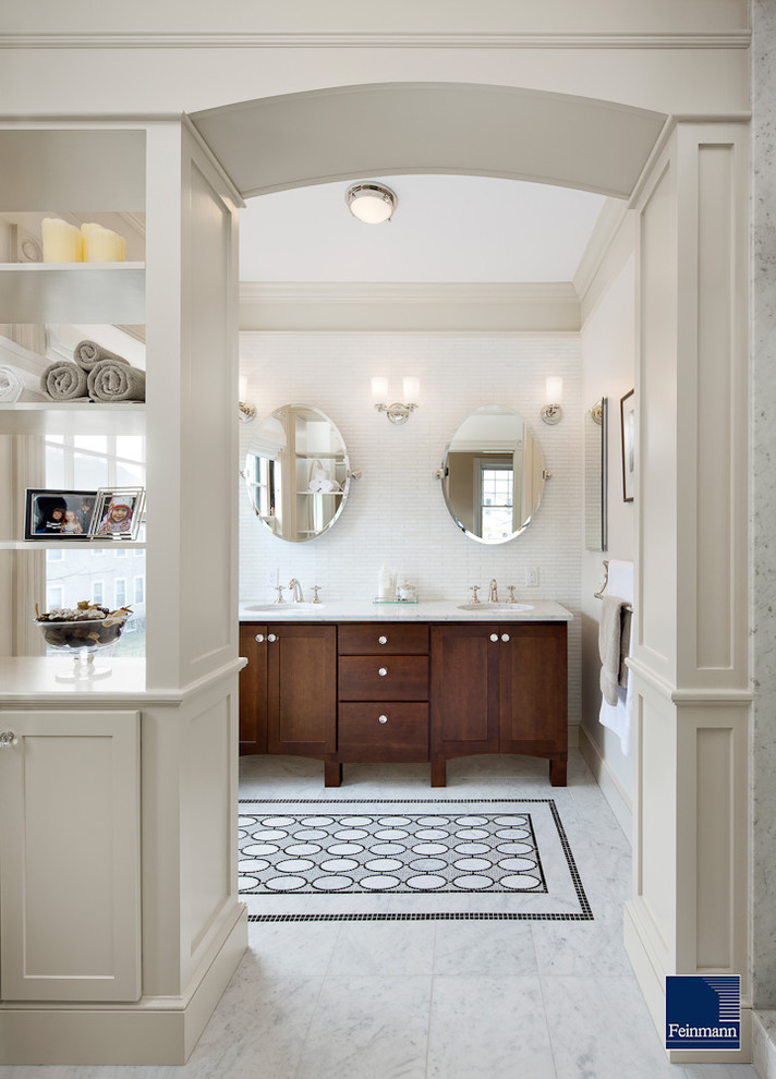 polished nickel mirror wall sconces white marble floor tile wooden vanity white countertop sinks faucets white cabinets windows towel holder
