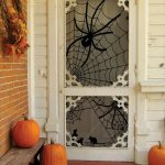 Porch With Big Spider Accessories On The White Door Glass, Orange Pumpkins, Bench,