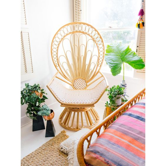 rattan chairs with peacock's tail pattern back, white cushion