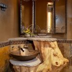 Rustic Bathroom With Branch Shaped Table With Golden Sink, Stone Top, Mirror, Yellow Sconces
