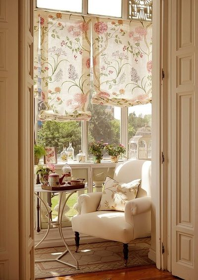 small sunroom with wooden floor, tiles, white chair, stainless steel small round table, white flowery curtain