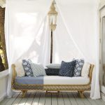 Sofa Bed From Rattan With White Cushion And Pillows, Curtain, Chandelier Inside The Curtain