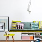 White Bench With Colourful Cushions And Pillows, Shelves Below
