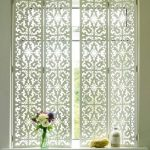 White Patterned Metal Plantation Shutters