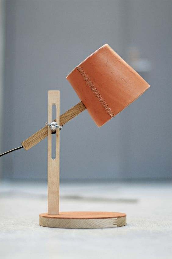 wooden table lamp with orange leather head