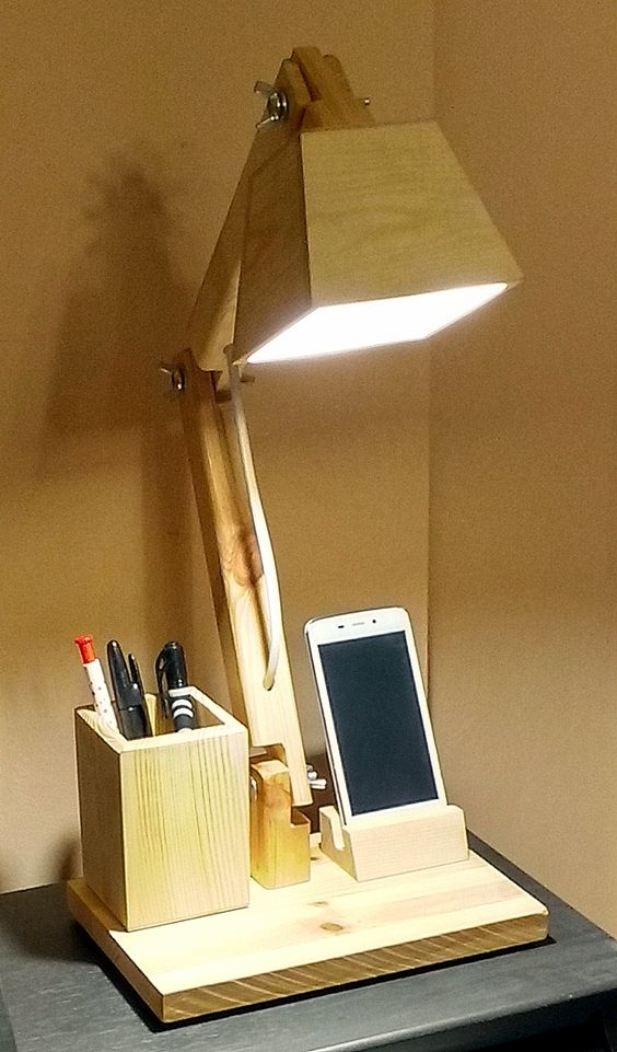 wooden table lamp with pens and phone holder