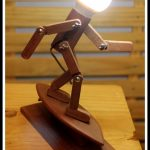 Wooden Table Lamps In The Shape Of A Person With Surfing Board