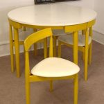 Yellow Dinner Table Set With White Top, Yellor Chairs With White Cushion Tidily Put Under