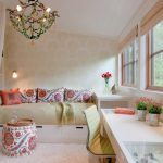 Daybed Room Ideas Chandelier Patterned Wallpaper Glass Windows White Desk Modern Office Chair Patterned Pillows Wall Sconces Throw White Curtain Ottoman