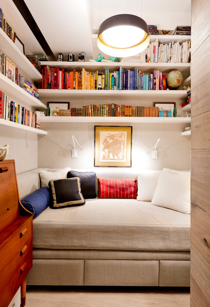 daybed room ideas wall mounted bookshelves beige bed wall sconces colorful pillows wooden drawers frame black ceiling lamp