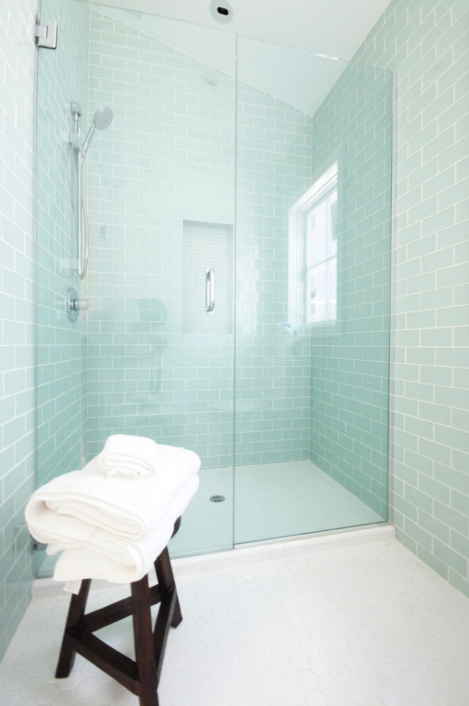 frameless shower door sweep blue porcelain wall tiles chrome shower fixture windows wooden stool white floor tile built in shelves
