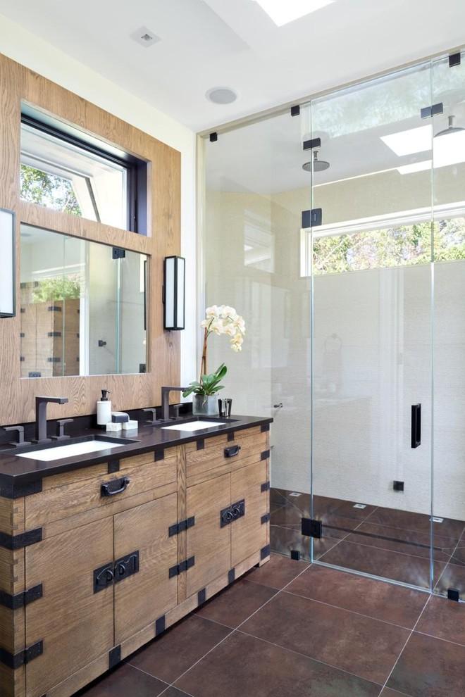 frameless shower door sweep brown floor tile industrial wooden vanity black top undermount sink faucet wall mirror wall scones rainfall shower head
