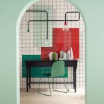 Home Office Space With White Red Green Block Of Tiles On The Wall, Industrial Lamps, Dark Wood Table, Green Chair