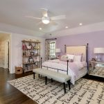 Light Purple Pillows Ceiling Fan With Lamp Iron Bed Bench Striped Bedding Mirrored Nightstands Table Lamps Windows Purple Walls Decorative Rug Wooden Shelves