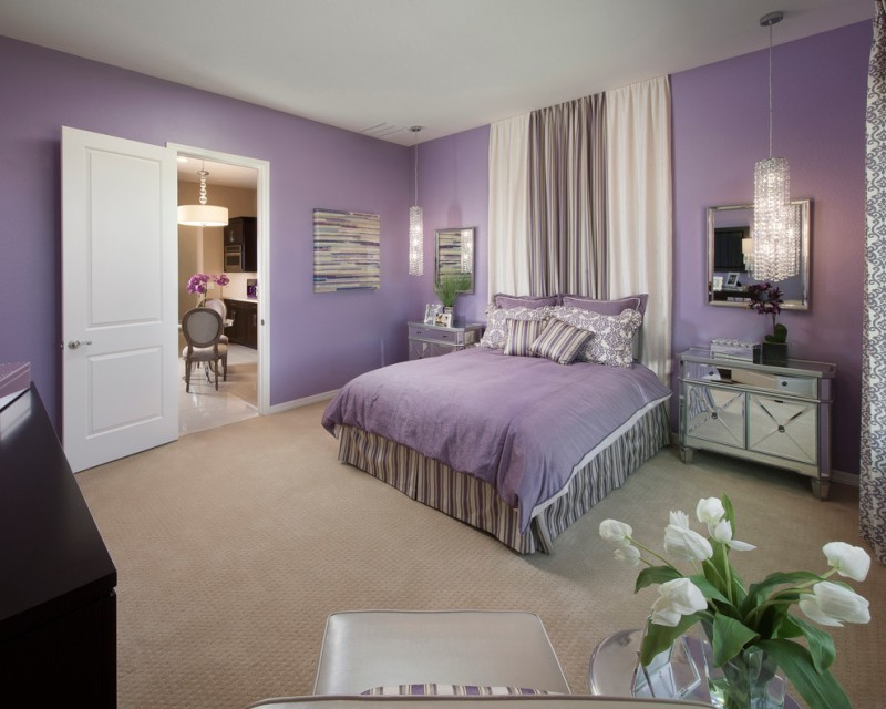 light purple pillows purple walls purple bedding crystal pendant lamps mirrored nightstands beige curtains colorful artwork wall mirrors glass side table