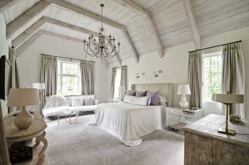 light purple pillows white bedding wall sconces white table lamps chandelier mirrored nightstands white couch glass table windows wooden ceilings