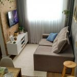 Open Space With Living Area With Dusty Brown Sofa, Brown Rug, White Cabinet, Tv, Woden Dining Set