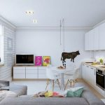 Open Space With White Small Kitchen, White Round Dining Set, White Cabinet Living Room With Grey Sofa And Pillows