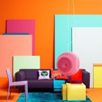 Orange Living Room With Colorful Board, Purple Sofa And Chair, Yellow Coffee Table, Blue Rug, Pink Round Lamp
